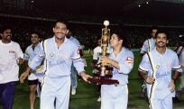 UBILANT INDIAN CRICKETT PLAYERS GREET CROWD AFTER BEATING WEST INDIES IN CRICKET ASSOCIATION OF BENGAL'S DIAMOND JUBILEE SIX NATION TOURNAMENT IN CALCUTTA. Jubilant Indian players (L-R) Kapil Dev, Captian Mohammed Azharuddin, Sachin Tendulkar (with Cup)
