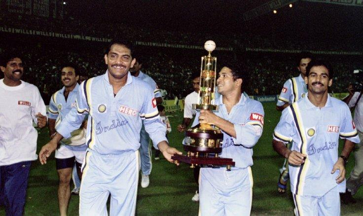 UBILANT INDIAN CRICKETT PLAYERS GREET CROWD AFTER BEATING WEST INDIES IN CRICKET ASSOCIATION OF BENGAL'S DIAMOND JUBILEE SIX NATION TOURNAMENT IN CALCUTTA. Jubilant Indian players (L-R) Kapil Dev, Captian Mohammed Azharuddin, Sachin Tendulkar (with Cup)