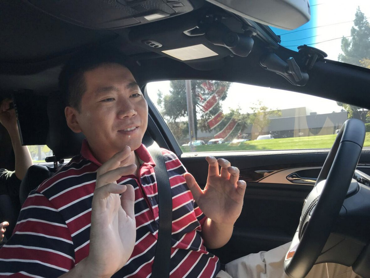 Nullmax CEO Lei Xu drives a Lincoln MKZ sedan equipped with his company's prototype self-driving hardware and software in Fremont, California
