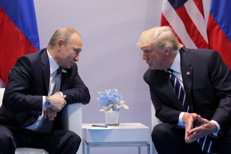 GermanyRussia's President Vladimir Putin talks to President Donald Trump during their bilateral meeting at the G20 summit in Hamburg
