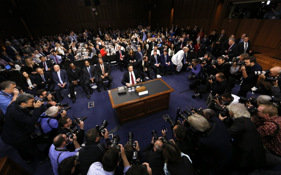 Former FBI Director James Comey prepares to testify before a Senate Intelligence Committee hearing on