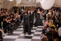 Models present creations of Dior