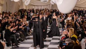 Models present creations of Dior