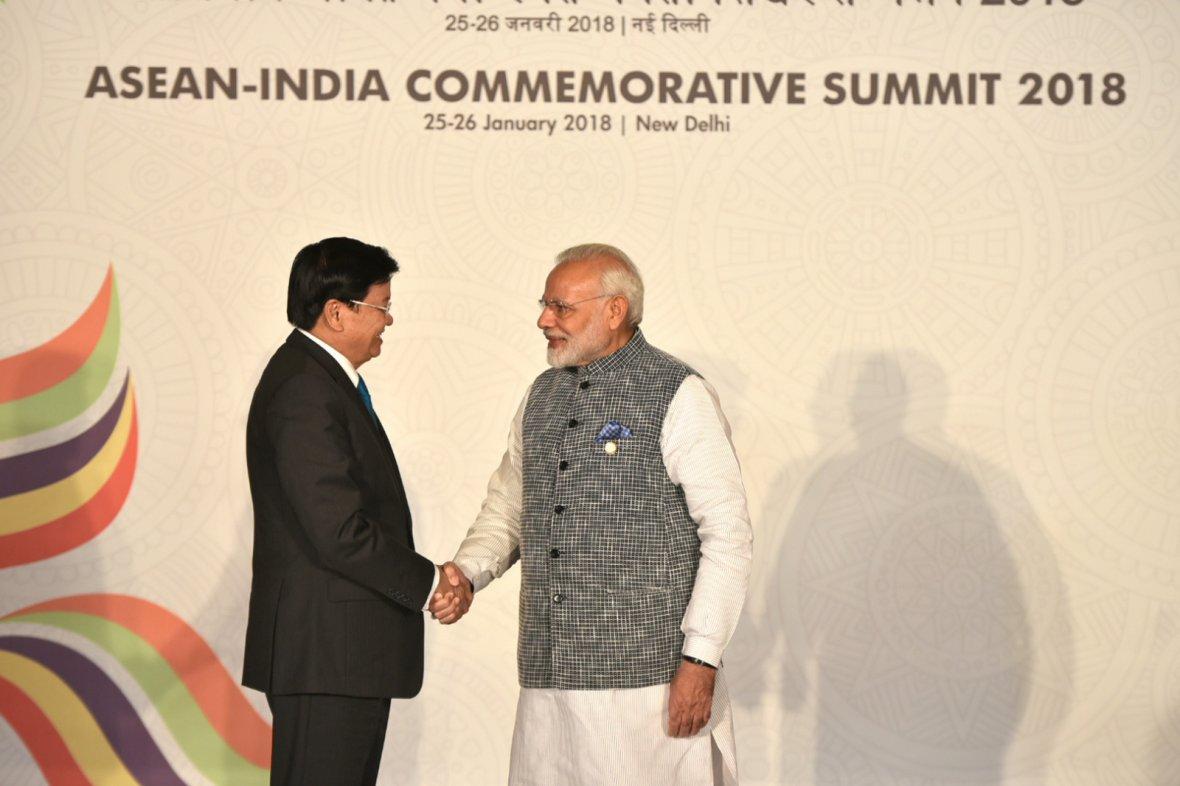 Prime Minister  Narendra Modi with the Prime Minister of Laos, Mr. Thongloun Sisoulith
