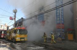Smoke rise from a burning hospital in Miryang