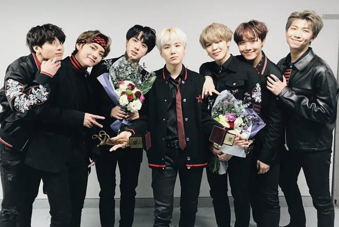 BTS holding their awards