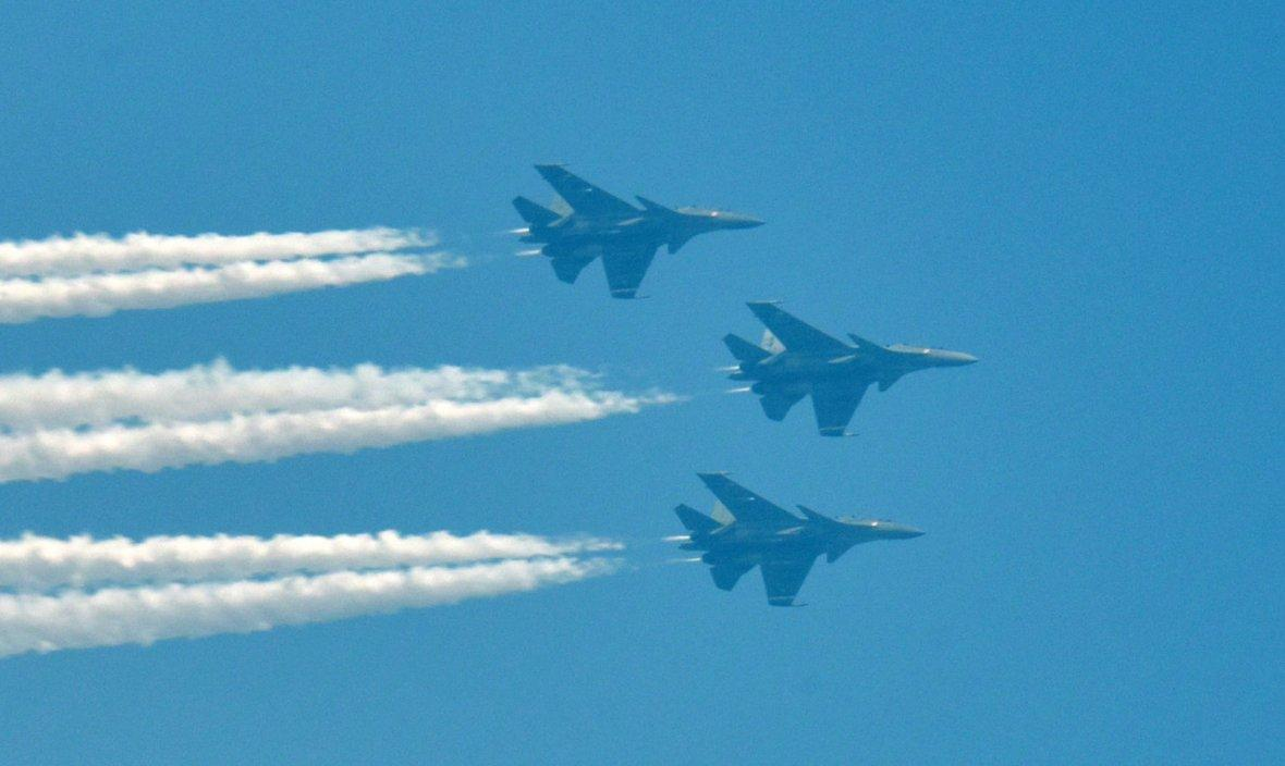 Three SU-30 MKI fighter planes fly over Rajpath