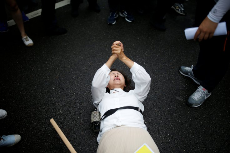 A Christian woman who opposes homosexuality tries to stop a march during the Korea Queer Culture Festival 2016 in central Seoul, South Korea, June 11, 2016.