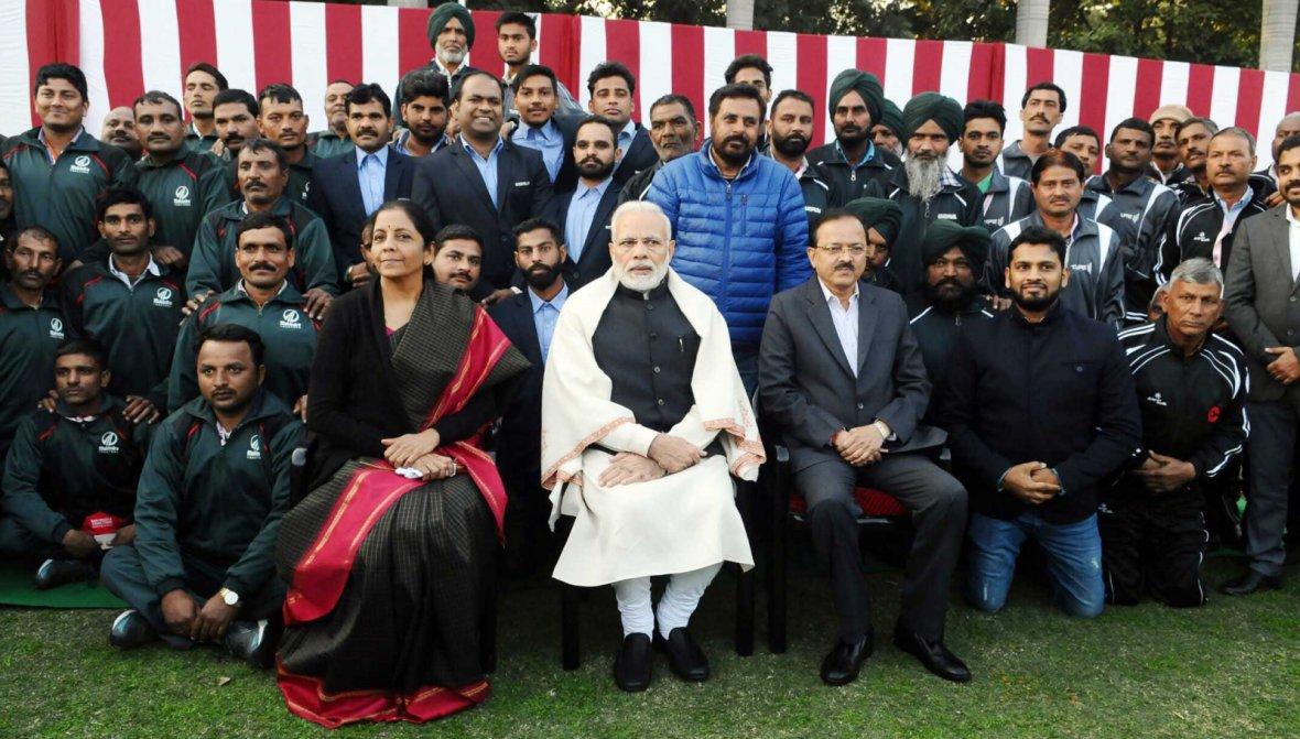 Prime Minister  Narendra Modi with NCC Cadets, NSS Volunteers, Tableaux Artists and tribal guests, at Teen Murti Bhawan, in New Delhi on January 27, 2018