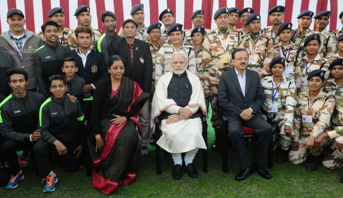Prime Minister  Narendra Modi with NCC Cadets, NSS Volunteers, Tableaux Artists and tribal guests, at Teen Murti Bhawan