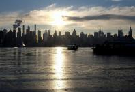 Ice coats the Hudson River as a river ferry departs for New York City from Weehawken, New Jersey, U.S.