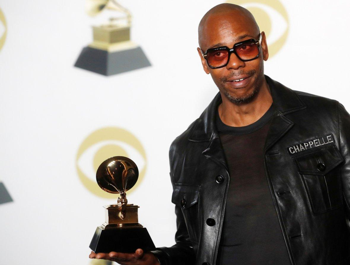 Dave Chappelle poses with his Grammy for Best Comedy Album for