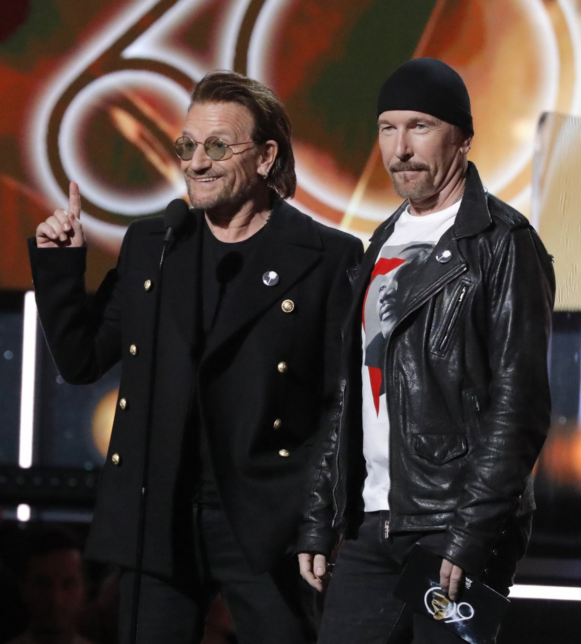 Bono (L) and the Edge present the award for album of the year