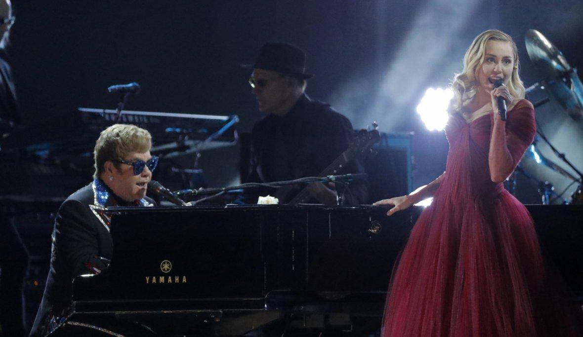 Elton John and Miley Cyrus perform Tiny Dancer
