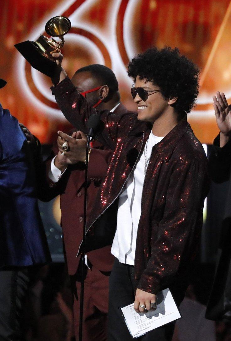 """Bruno Mars accepts the Grammy for song of the year for """"That's What I Like."""""""