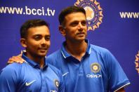 India's Under-19 Cricket team Captain Prithvi Shaw and coach Rahul Dravid during a press conference in Mumbai on Dec 27, 2017.