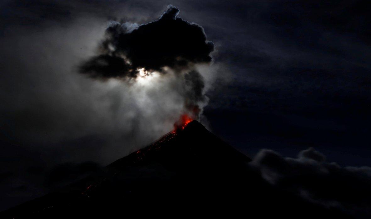 super blue moon illuminates Mayon Volcano as it spews lava during a mild eruption