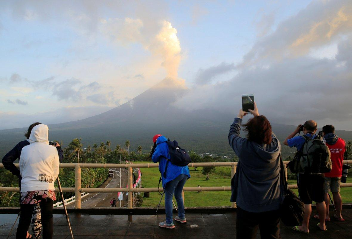 PhilippinesVisitors take pictures of volcanic ash spewing out of a crater of Mount Mayon volcano during an eruption in Camalig