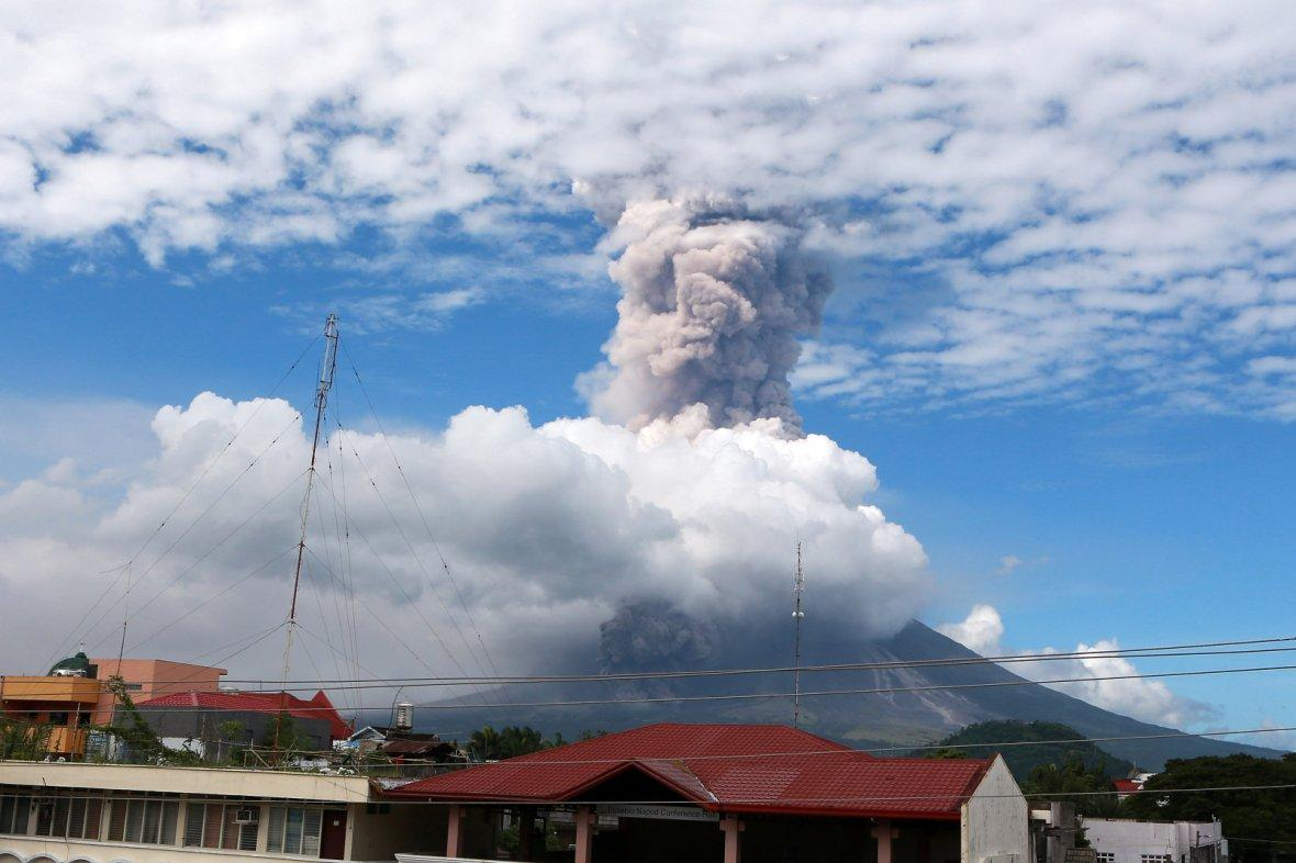 Ash plumes rise from the crater of Mayon volcano in Albay Province, the Philippines
