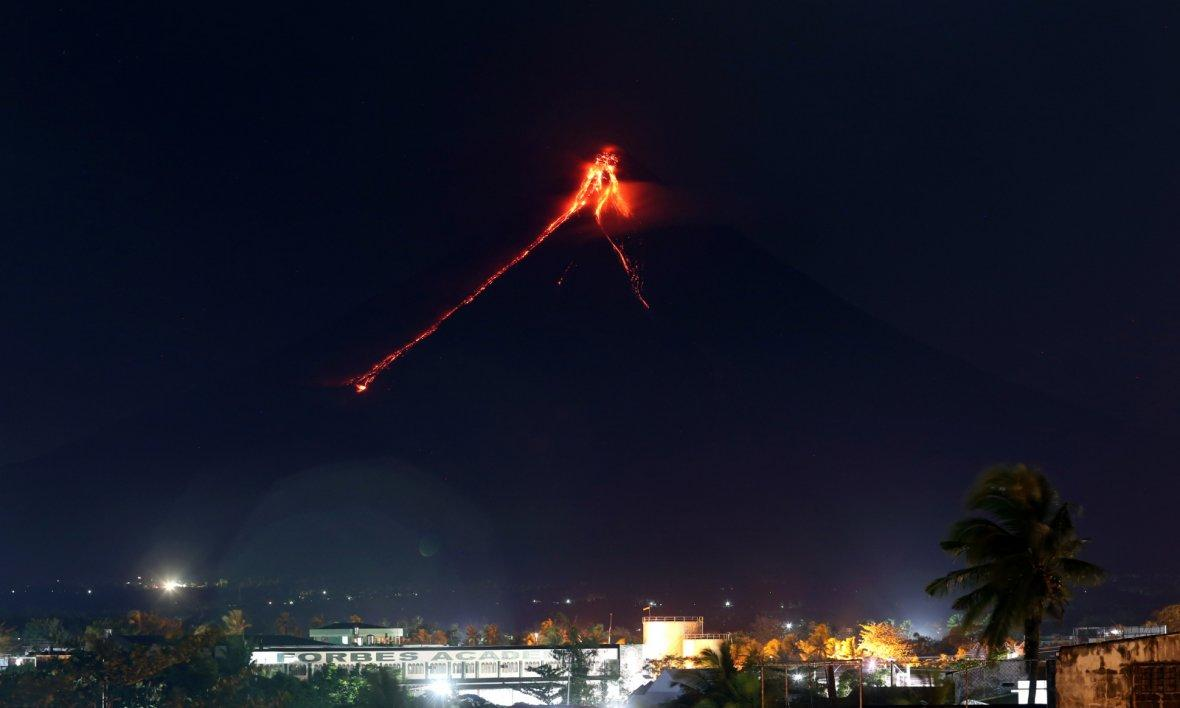 Glowing lava is seen as it flows from the crater of Mayon Volcano in Albay Province, the Philippines