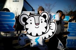 2018 PyeongChang Winter Olympics mascot Soohorang is seen as South Korean supporters cheer for the inter-Korean women's ice hockey athletes before their friendly match against Sweden in Incheon, South Korea,