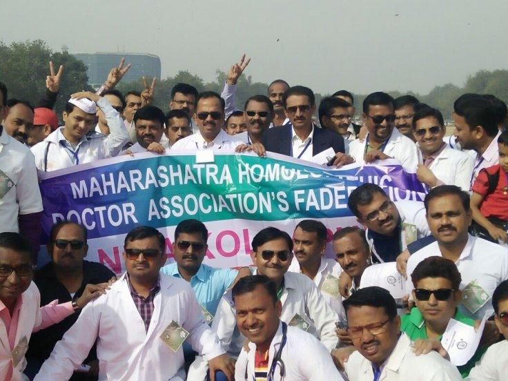 Members of Maharashtra Homeopathic Doctor Association's Federation participate in a rally to support National Medical Commission Bill