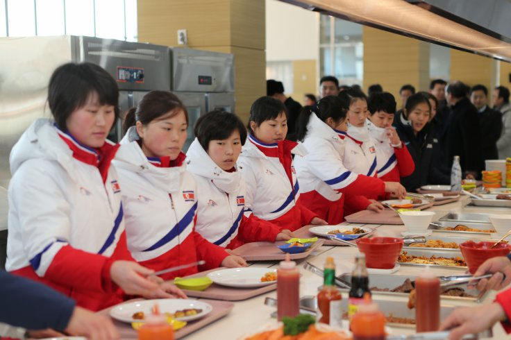 North Korea women's ice hockey athletes stand in a line at a dining hall at the Jincheon National Training Centre in Jincheon