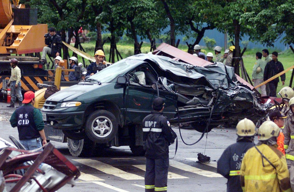 Rescue workers remove car crashed in Taiwan Earthquake