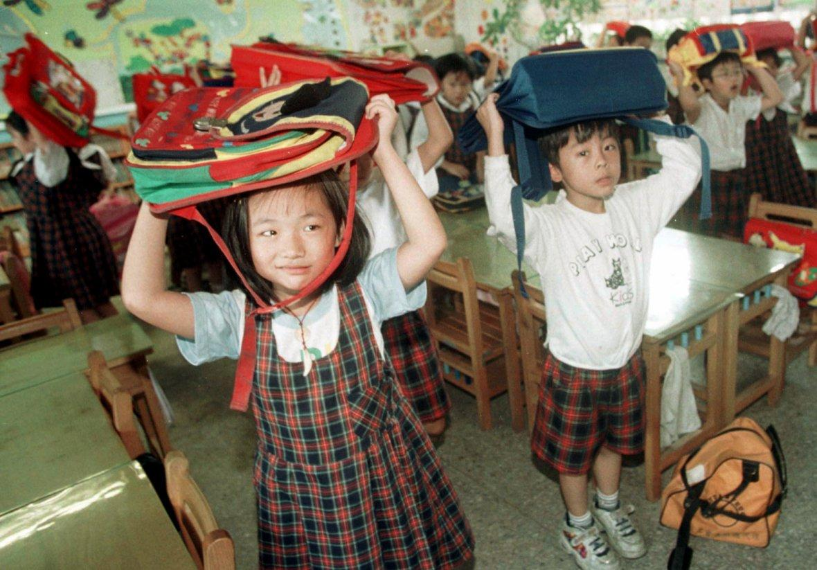 School children practice anti-earthquake skill in Taipei