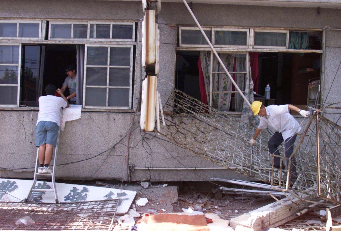 Residents try to retrieve their belongings in Tungshih.