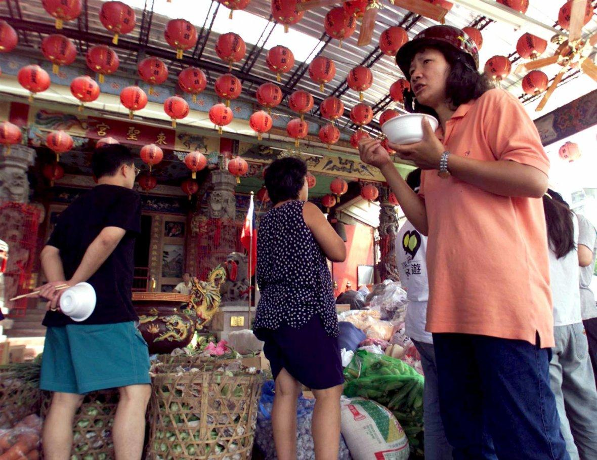 Residents queue up for food at temple in Tungshih.