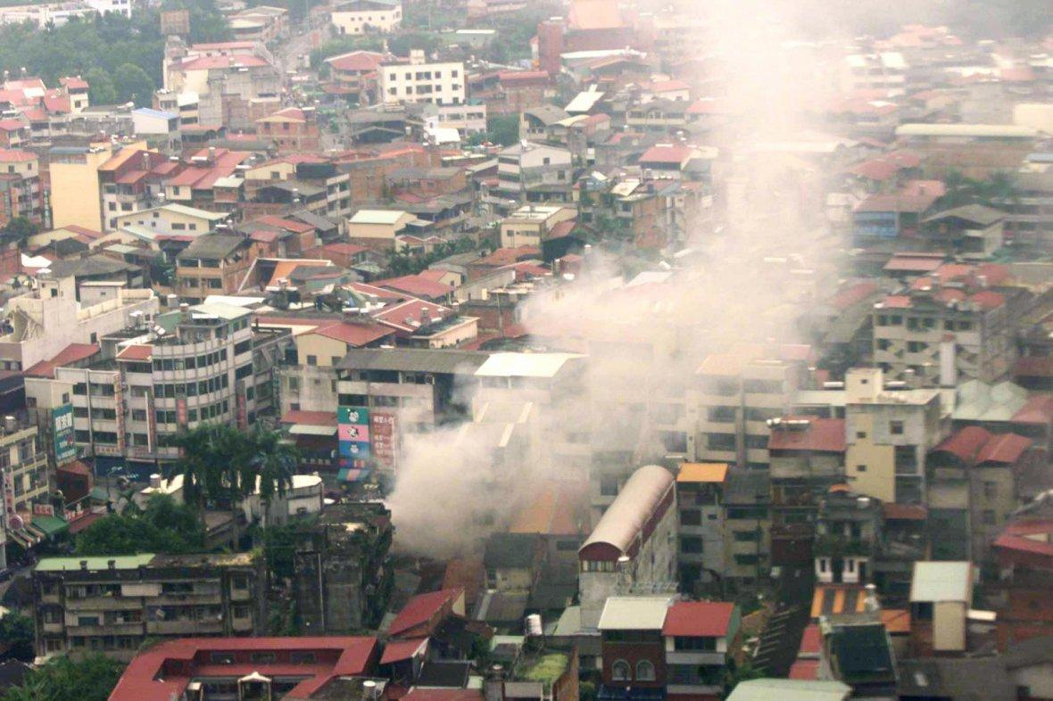 Aerial view showing smoke rises from collapsed building in PU LI.