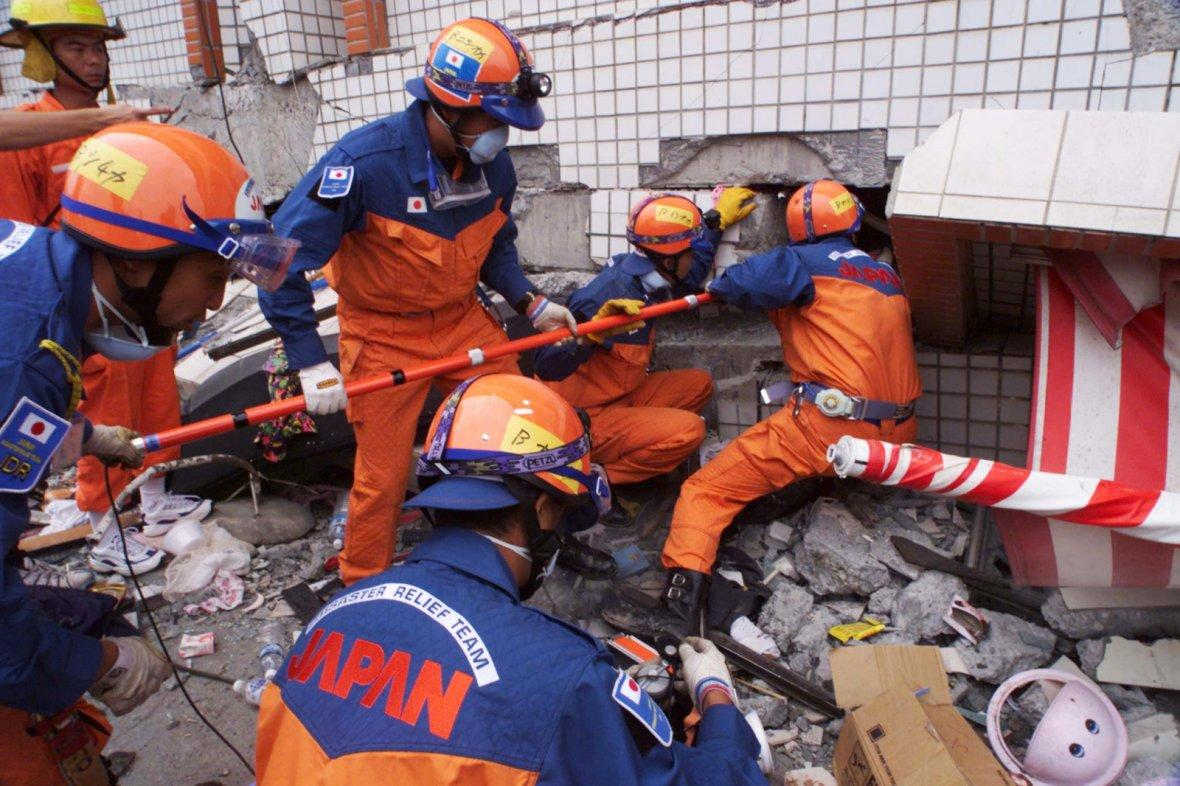 Japanese rescue team check for survivors after earthquake in PULI.