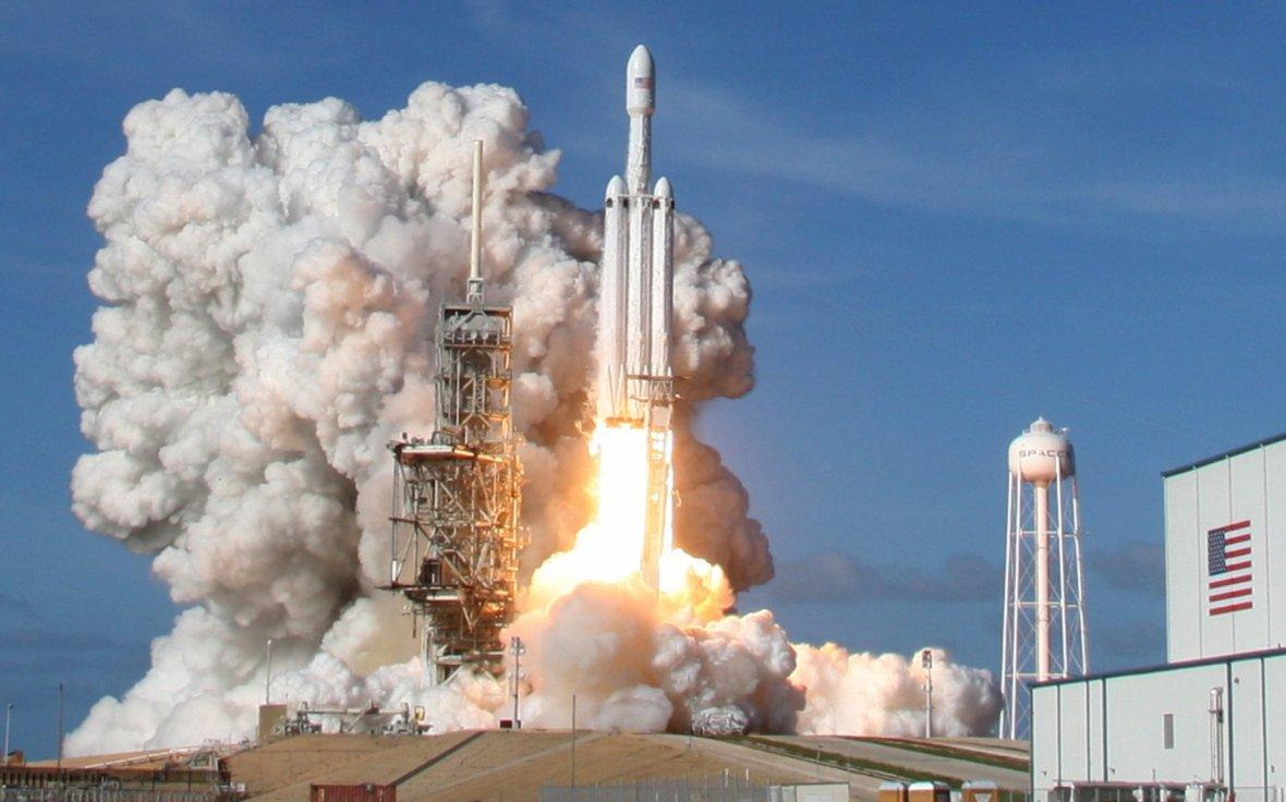 A SpaceX Falcon Heavy rocket lifts off from historic launch pad 39-A at the Kennedy Space Center