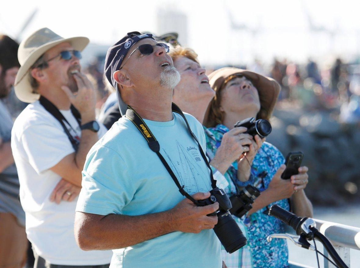 Spectators watch SpaceX's first Falcon Heavy rocket launches from the Kennedy Space Center in Florida