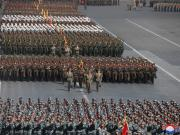 Soldiers march during a grand military parade celebrating the 70th founding anniversary of the Korean