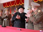 North Korean leader Kim Jong Un attends a grand military parade celebrating the 70th founding anniversary