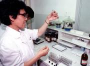 Lab technician checking sample in Beijing.