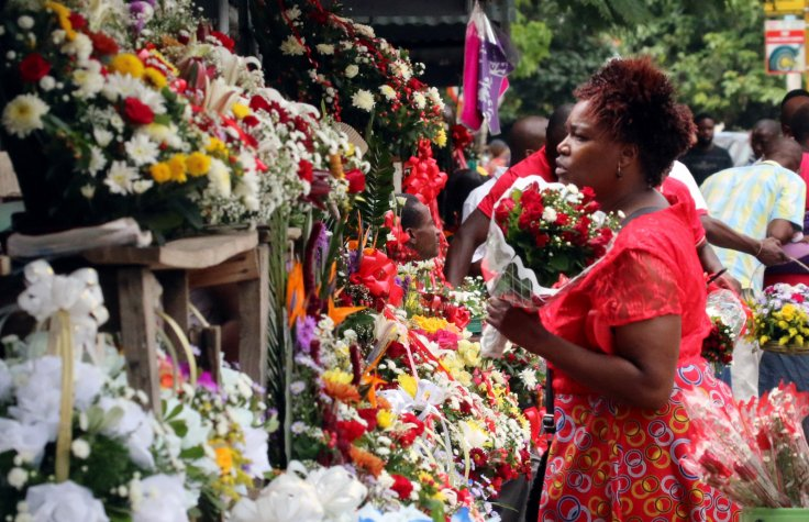 A woman buys flowers at a market on Valentine's Day in Harare