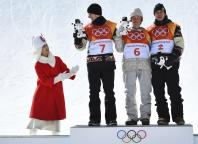 Men's Slopestyle Finals - Phoenix Snow Park - Pyeongchang, South Korea - February 11, 2018 - Gold medallist Redmond Gerard of the U.S., flanked by silver medallist Max Parrot of Canada and bronze medallist Mark McMorris of Canada, receive their game masco