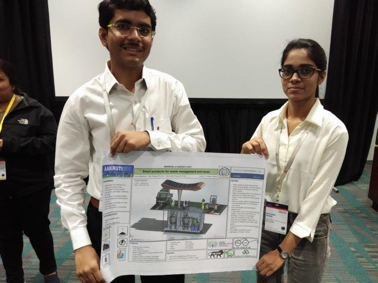 "Yash Dhake, a mechanical engineering student and Samruddhi Dhake, a computer engineering student from Chinchwad College of Engineering in Nigadi, Pune with their model at the annual ""SOLIDWORKS WORLD 2018"" conference in Los Angeles."