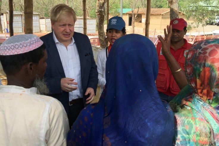 British Foreign Secretary Boris Johnson talks to Rohingya Muslim refugees from Myanmar