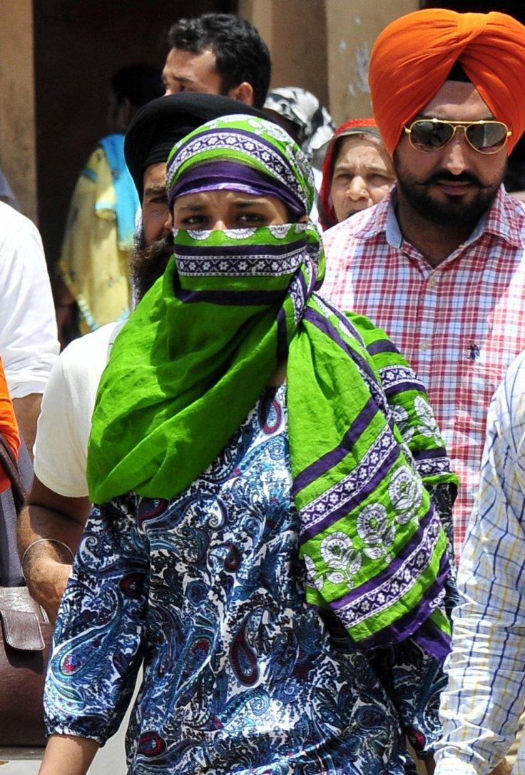 People cover their faces to avoid direct contact with sun on a hot day