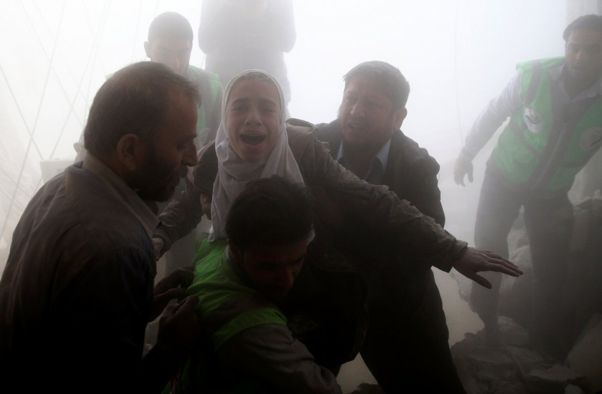Damascus, SyriaMen evacuate a girl from a site hit by an airstrike in the rebel-held Douma neighbourhood of Damascus, Syria