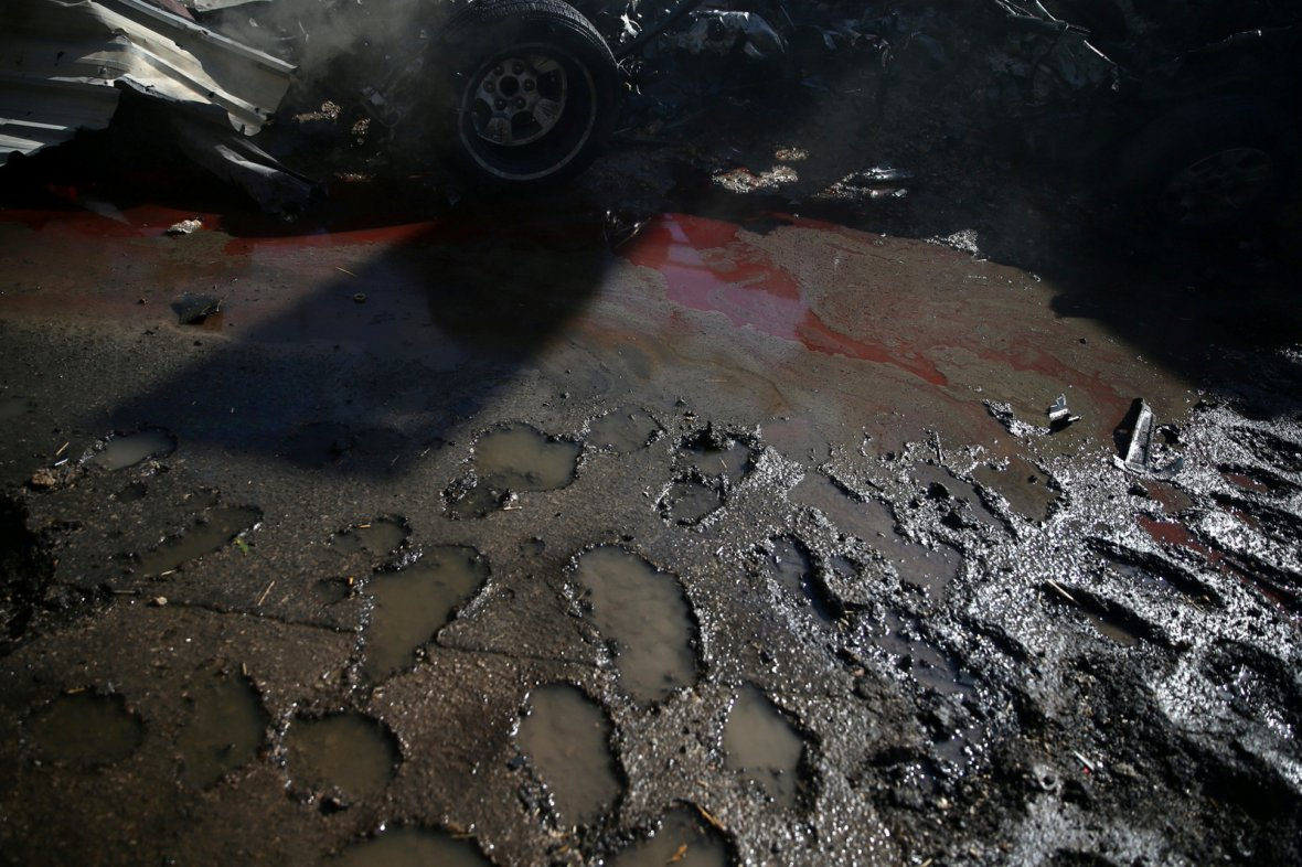 Blood stains the damaged ground after a strike on the rebel held besieged city of Douma, in the eastern Damascus suburb of Ghouta, Syria
