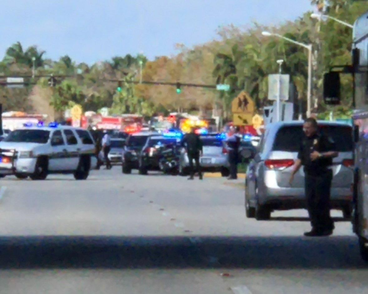 Police cars are seen in Coral Springs after a shooting at the Marjory Stoneman Douglas High School in Parkland, Florida