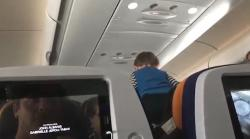 Demonic child inside plane