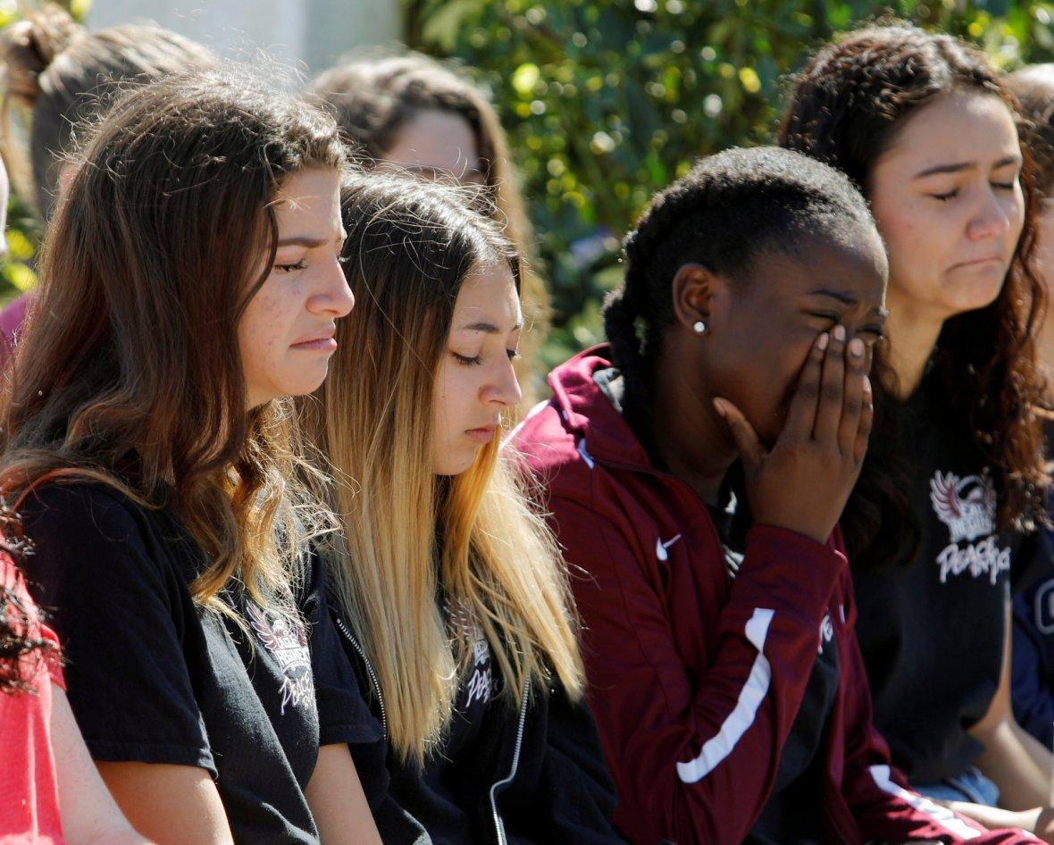 Students mourn at a community prayer vigil for victims of yesterday's shooting at nearby Marjory Stoneman Douglas High School in Parkland