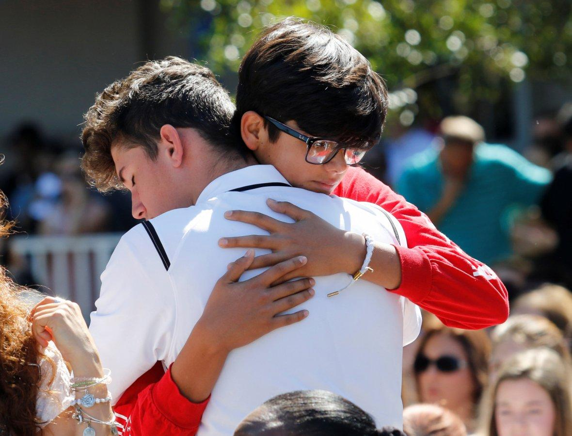 SStudents from Marjory Stoneman Douglas High School attend a memorial following a school shooting in Parkland