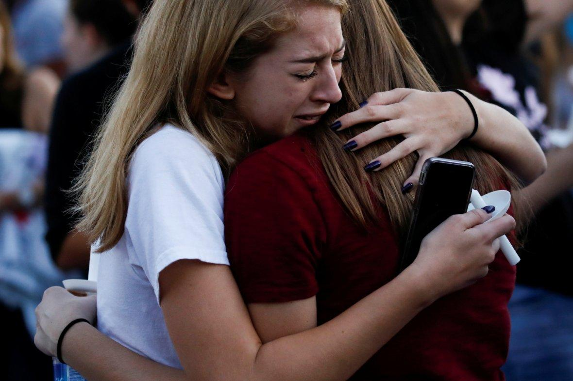 Students mourn during a candlelight vigil for victims of yesterday's shooting